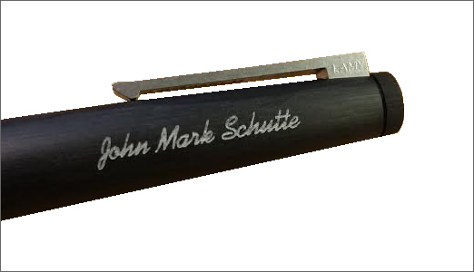 Pen engraved on cap with script font