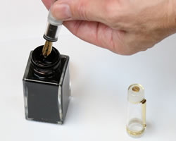 How to fill a piston fountain pen - dip in ink